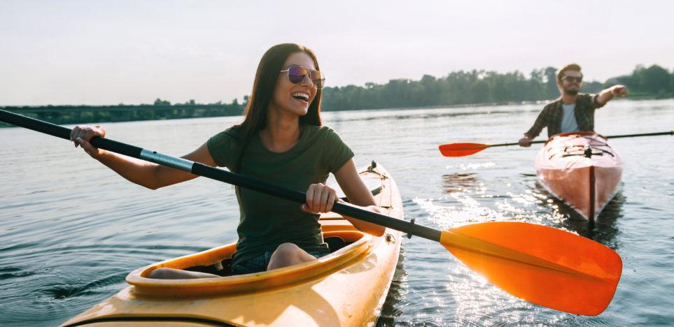 couple kayaking together on lake